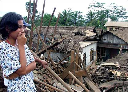 A woman stands in the wreckage of Sijeruk village in Banjarnegara district, Central Java, Indonesia Wednesday Jan. 4, 2006.