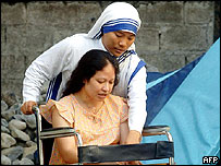 A nun wheels Australian-Filipina Vivian Alvarez from a convent hospice in the northern Philippine city of Olongapo, 13 May 2005.