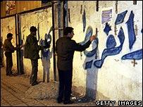 Activists paint election slogans on Gaza walls