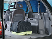 Photo of the Indipod packed away in the back of an MPV