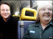 David Cameron with Doreen Ingram, one of the ambulance crew that takes his disabled son to school