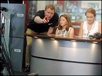 A pair of presenters get tips from BBC staff