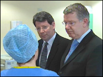 Prof Kerr (centre) and Health Minister Andy Kerr