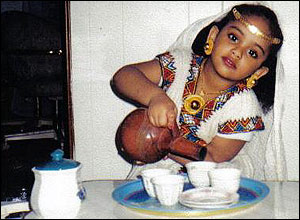 Child pretending to pour coffee