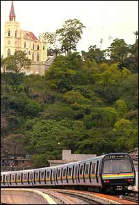 An underground train travelling overground on part of the railway line in Caracas