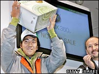 Man holding up his new Xbox 360