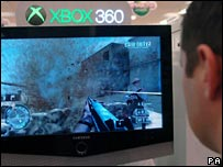Man playing game on an Xbox 360