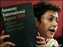 Amnesty International's Secretary General Irene Khan holds a copy of the Amnesty International Report 2005