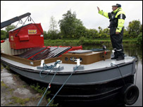 Freight being lowered onto a barge
