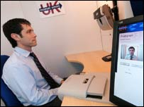 A BBC reporter takes a biometric scan