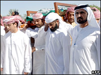 Members of the royal family including Sheikh Mohammed bin Rashid Al Maktoum carry the body of Sheikh Maktoum