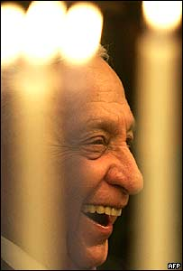 Ariel Sharon smiles as he takes part in the lighting of a Hanukkah candle on 27 December 2005