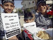 Palestinian children celebrate news of Ariel Sharon's ill-health