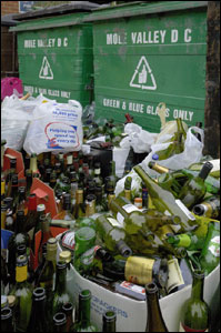 Christmas and New Year's bottles to a bottle bank in the relatively small village of Bookham, Surrey, England