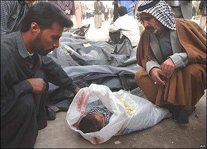Relatives identify a dead infant after a bomb in Karbala