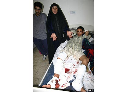A distraught mother and her injured son at the Husseini hospital in Karbala
