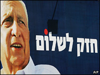 "A billboard with a picture of Ariel Sharon next to a slogan that reads in Hebrew ""a strong leader for peace"""