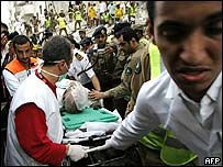 Man injured in Mecca building collapse is taken away o a stretcher