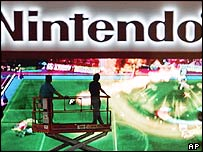 Workers examine a giant Nintendo game screen