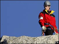 Prince William carrying out a mock mountain rescue