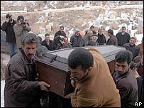 Mourners carry the coffin of Fatma Kocyigit