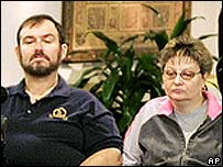 Randal McCloy's mother Tambra Flint (right) with her husband in hospital