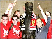 Liverpool fans celebrate victory at John Lennon Airport