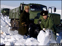 Chinese soldiers clear snow to rescue a truck stranded at Altay, northwest China's Xinjiang province