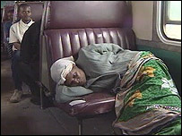 Woman sleeping on a seat in the train carriage