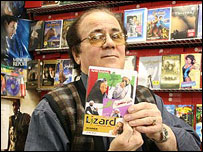 Video shop customer shows Iranian film DVD