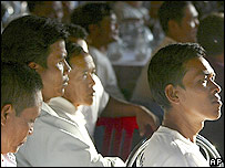 Opposition party members listen pensively to their exiled leader, Sam Rainsy's speech, via telephone from France, at the party headquarters in Phnom Penh Tuesday Nov. 29, 2005.