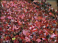 Fans wait for the victory parade