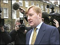 Charles Kennedy leaves his home on Friday