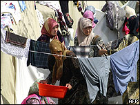 Uzbek women dry clothes at a refugee camp at the Uzbek-Kyrgyz border