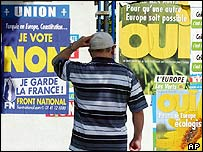 Man looks at French referendum posters