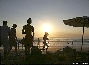 Tourists enjoy sunset on Dreamland beach May 22, 2005 in Bali Resort Island, Indonesia.