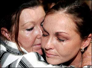 Australian beauty therapist Schapelle Corby, right, receives a kiss from her mother