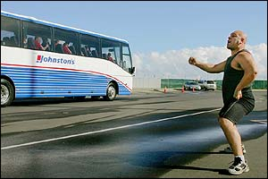 As the players leave the airport a single All Blacks supporter performs the haka