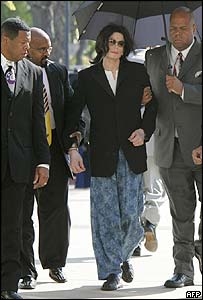 Jackson is escorted into the court by aides after injuring his back