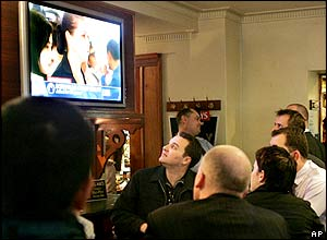 People in a Sydney bar in Australia, Friday, May 27, 2005, watch a live telecast of the Schapelle Corby trial.