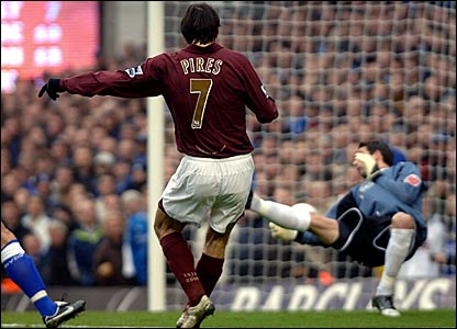 Robert Pires scores the first of two goals for Arsenal against Cardiff