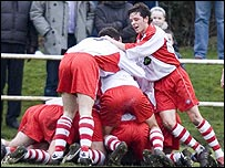Jubilant Spartans celebrate their opening goal