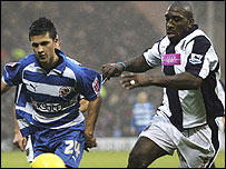 Reading's Shane Long is challenged by West Brom's Darren Moore