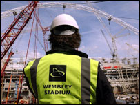 A workman inside Wembley Stadium