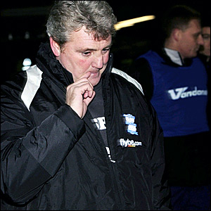 Birmingham boss Steve Bruce leaves the pitch at Plainmoor after watching his side held by Torquay