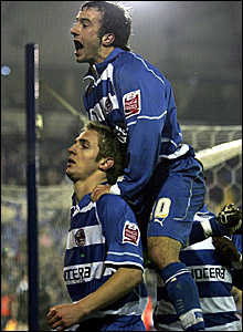 Kevin Doyle (bottom) is congratulated by Stephen Hunt after scoring Reading's equaliser at The Hawthorns