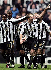 Alan Shearer celebrates scoring his 200th goal for Newcastle