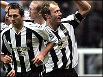 Alan Shearer celebrates equalling Jackie Milburn's scoring record for Newcastle
