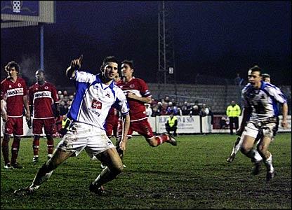 Nuneaton's Jez Murphy celebrates after scoring a penalty