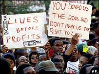 A crowd shows posters during an Aids march in Durban, South Africa